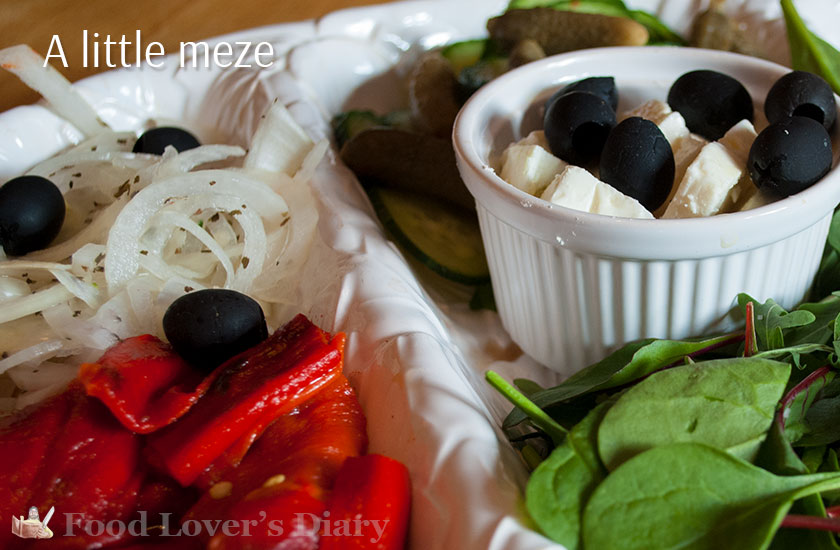 A very basic meze of olives, peppers, onions and salad